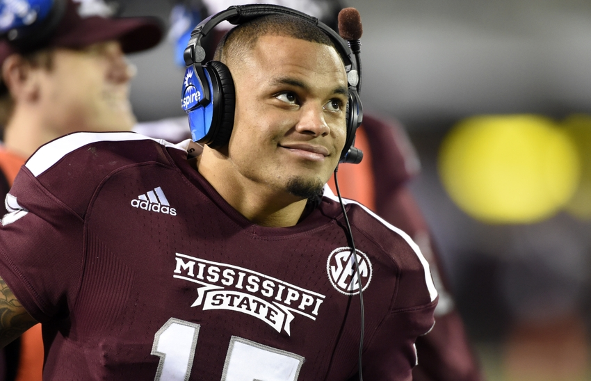 Nov 8, 2014; Starkville, MS, USA; Mississippi State Bulldogs quarterback  Dak Prescott (15) smiles while on the headsets after coming out of the game  against ...